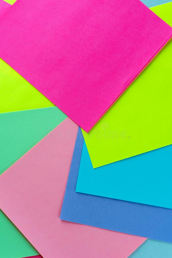 Colorful neon paper background. Swirling kaleidoscopic geometric pattern of bright colors. royalty free stock photography