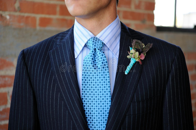 Blue Pinstriped Suit with Tie and Boutonniere royalty free stock photo