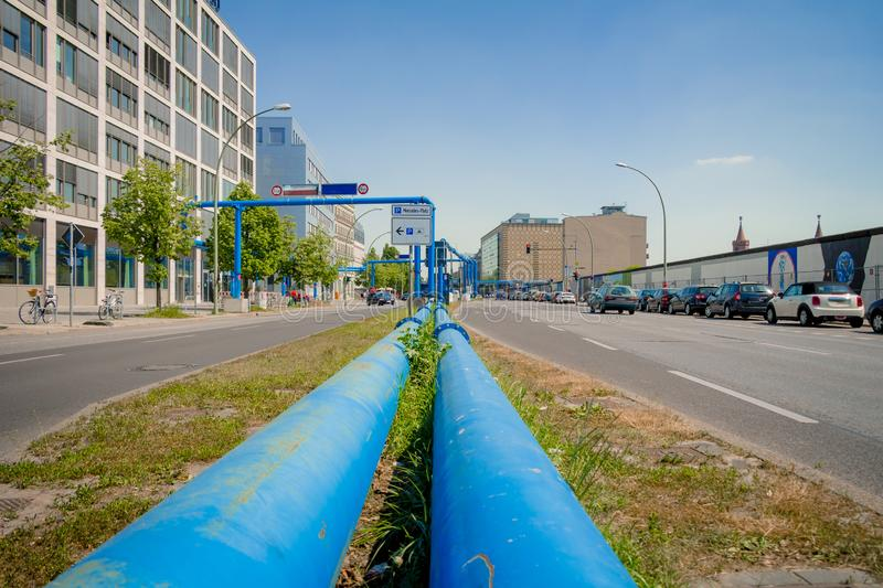 Blue pipes at the street of Berlin city royalty free stock photo