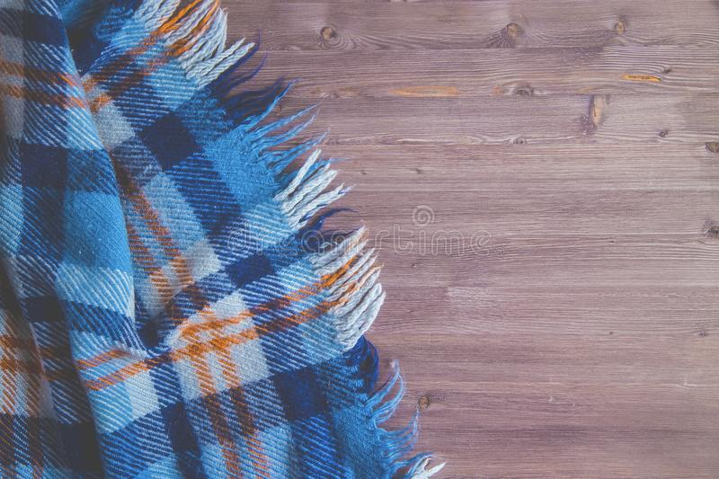 Blue Plaid on a wooden background Top view. Blue Plaid on a wooden background Copt space royalty free stock photography