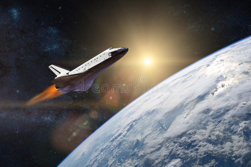 Blue planet Earth. Space shuttle taking off on a mission. stock images