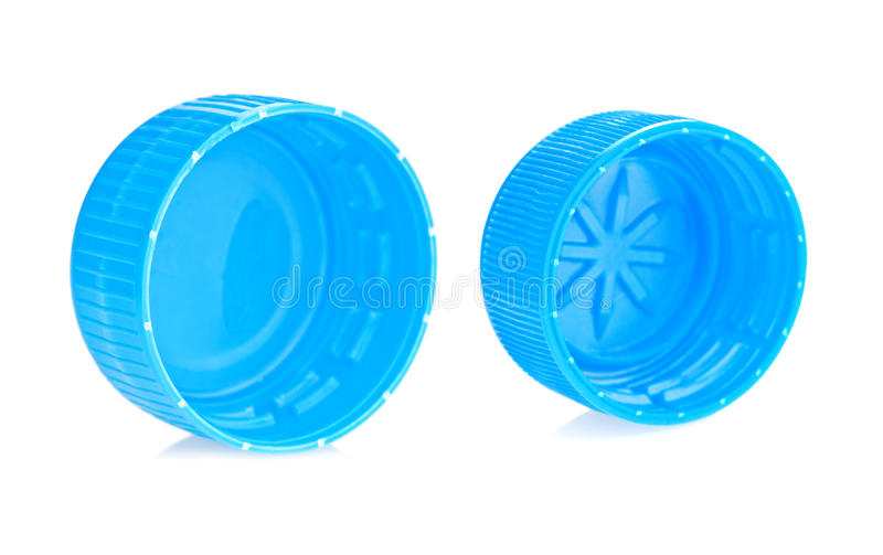 Blue plastic bottle caps. Two blue plastic bottle caps isolated against a white background stock photos