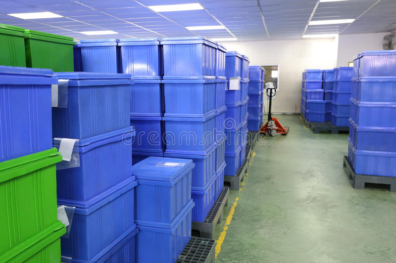 Blue Plastic box products in Industrial factory room. Blue Plastic box products in Industrial factory room,Container of finished goods germ-free stock photos