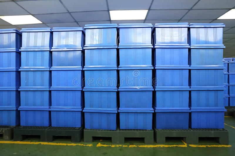 Blue Plastic box products in Industrial factory room. Blue Plastic box products in Industrial factory room,Container of finished goods germ-free royalty free stock photos