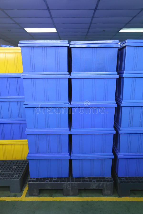 Blue Plastic box products in Industrial factory room. Blue Plastic box products in Industrial factory room,Container of finished goods germ-free stock photography