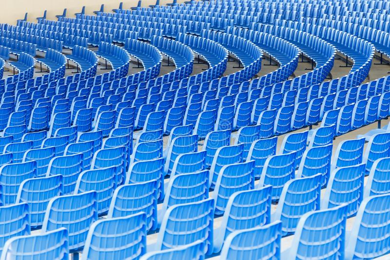 Blue plastic chairs arranged in rows around the circle in the hall for business presentations stock photos