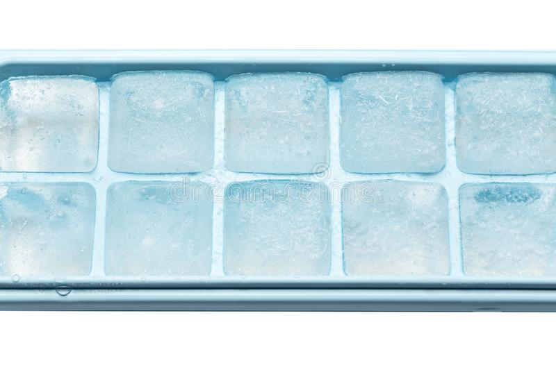 Plastic ice cube tray with frost stock images