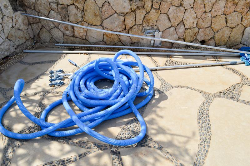 Blue plastic long large corrugated hose for cleaning the pool wash and watering the plants stock photography
