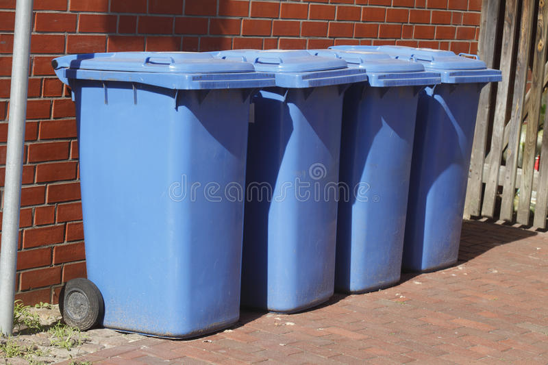Blue plastic reciyling bins. For waste paper stock image