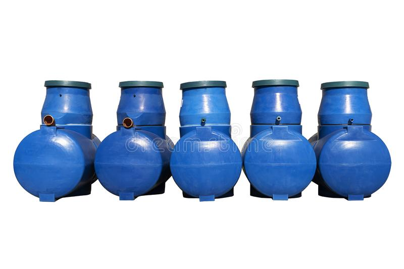 Blue plastic septic tanks are standing. Five cylindrical containers in a row. Isolated white background, a large of sewage stock images