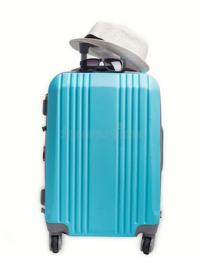 Blue plastic suitcase, hat sunglasses isolated on white background. royalty free stock photography