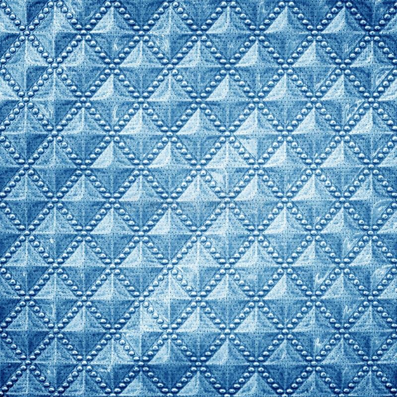 Blue plastic texture pattern is a diagonal colored square for b. The blue plastic texture pattern is a diagonal colored square for background stock photos