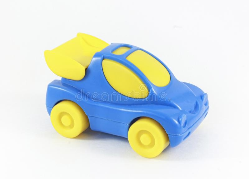 Blue plastic toy car with yellow wheels and yellow glass royalty free stock photography