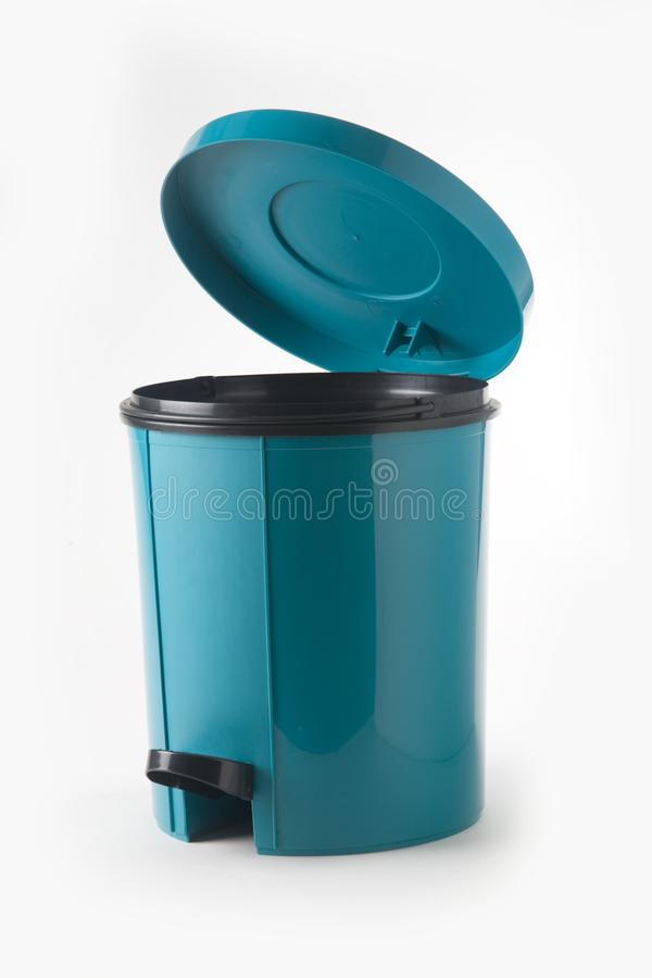 Blue plastic trash can royalty free stock photos