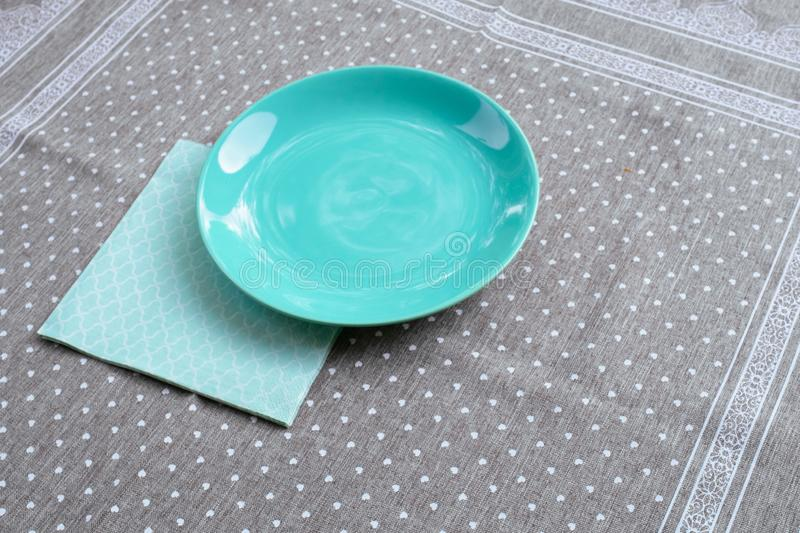 Blue green plate table breakfast napkin grey background paper stock image