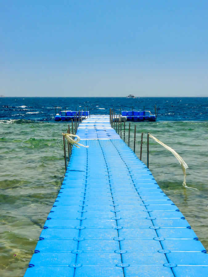 Blue pontoon on sea. Blue pontoon on sea in Egypt. Cloudless sky stock images