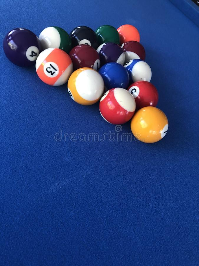 Blue Pool Table coloured numbered balls. In triangle formation stock images