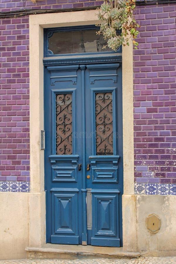 Blue portuguese wooden door stock photo