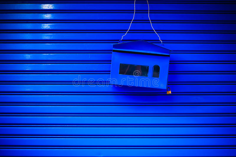 Post mail box. Blue post box on blue background stock images
