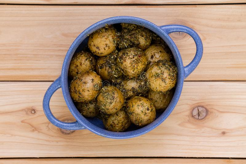Blue pot full of seasoned boiled baby potatoes royalty free stock image