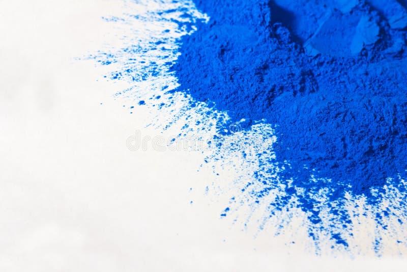 Blue powder on white royalty free stock photo