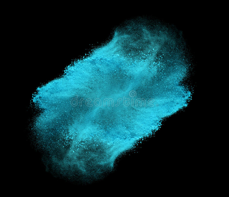 Blue powder explosion isolated on black background stock photos