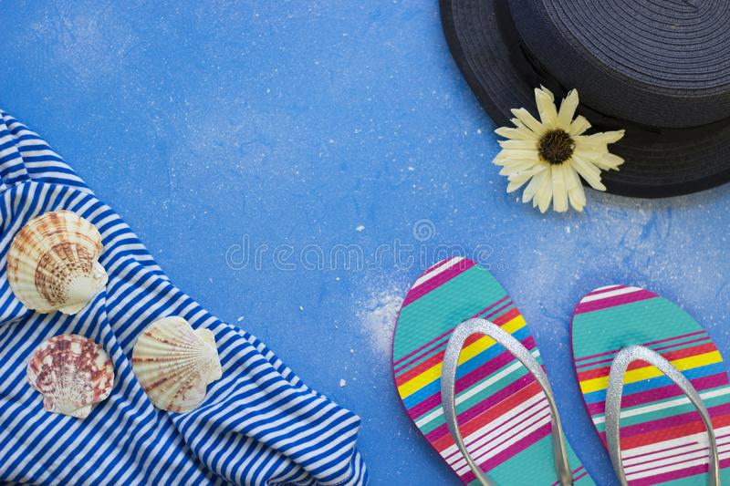 Blue powdered background with tourist`s items royalty free stock images