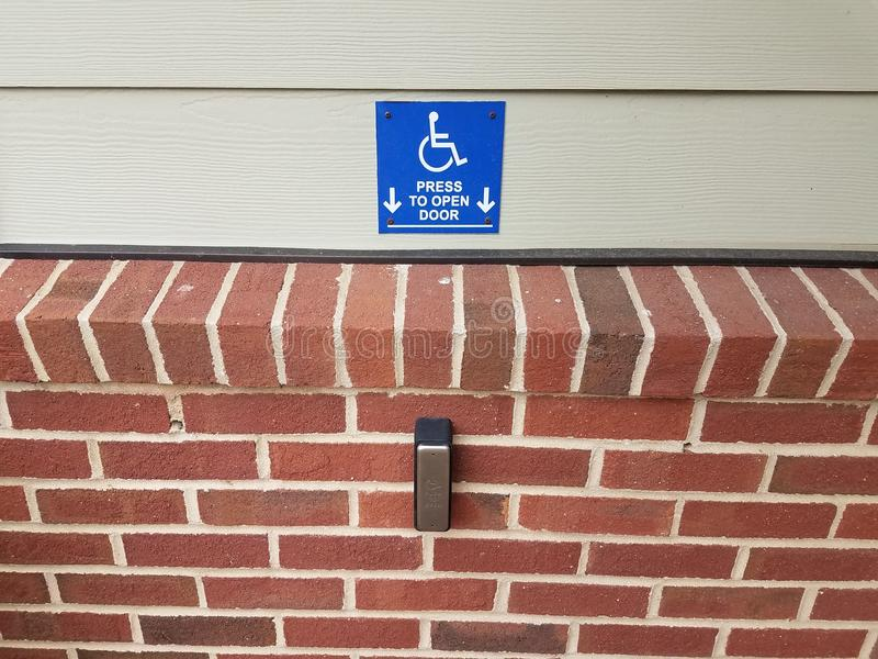 Blue press to open wheelchair button and red bricks royalty free stock images