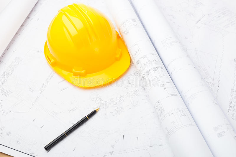 Blue print and safety helmet royalty free stock photography
