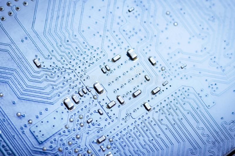 Blue printed circuit Board with microchips and conductors. Close-upn royalty free stock images