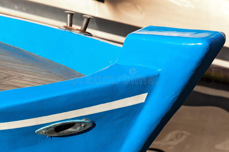 Blue Prow of Rowing Boat. Detail of a prow of a blue and white rowing boat. Liguria, Italy stock image