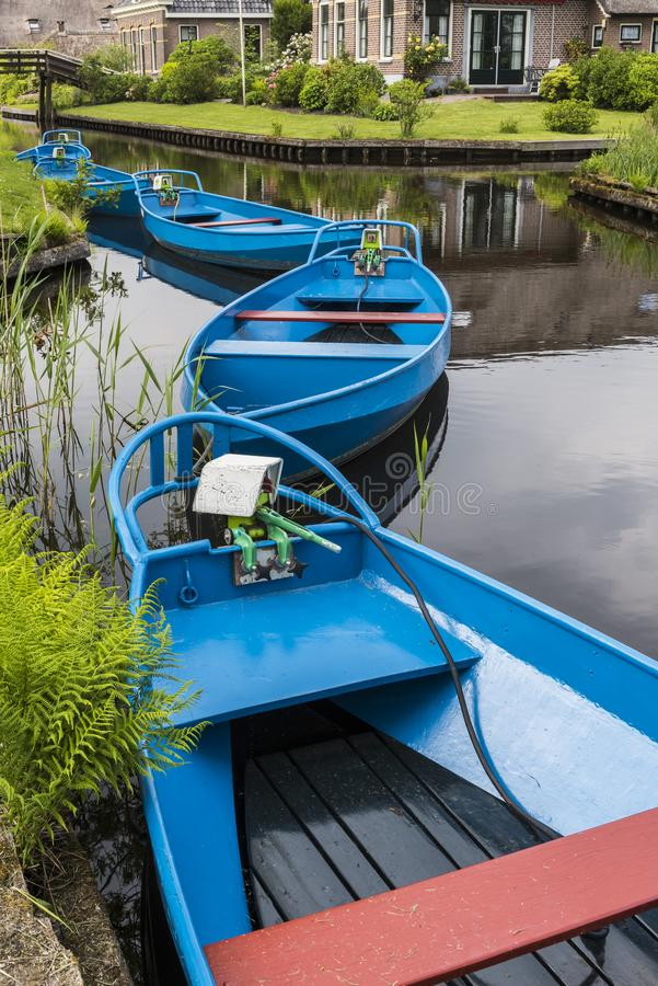 Blue Punter Boats Giethoorn. Blue Punter Boats in the small, picturesque town of Giethoorn, Overijssel, Netherlands royalty free stock image