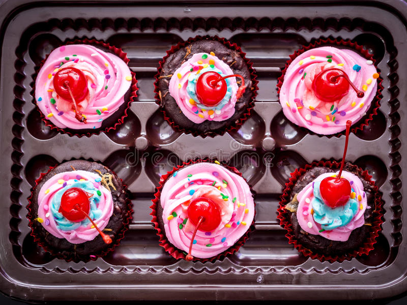 Blue-Purple Vegan Cupcakes with Cherry on Top stock photography