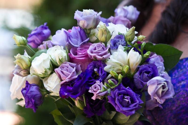 Blue, purple and white wedding bouqet. Beautiful blue, white and purple wedding bouqet royalty free stock photography