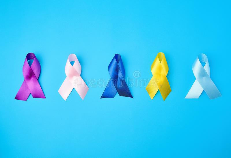 blue, purple, yellow, blue, pink ribbon in the form of a bow stock photography