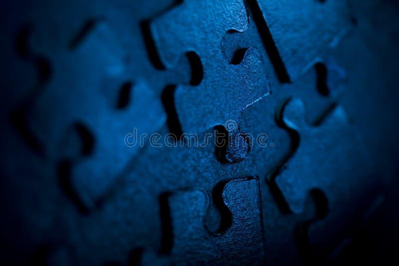 Blue puzzle parts stock photos