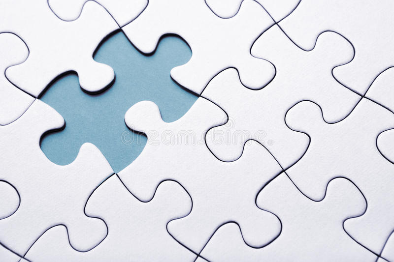 Blue puzzle piece missing stock photo