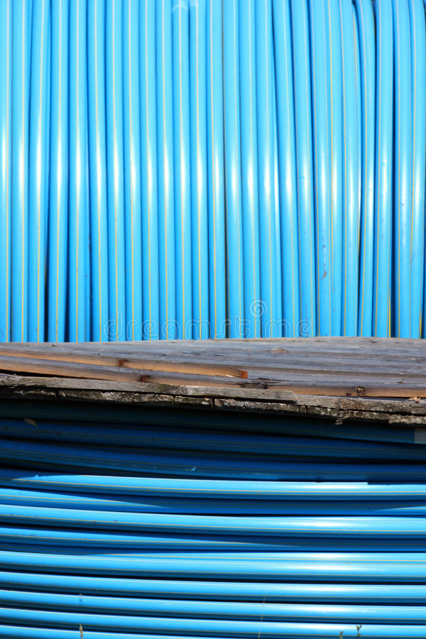 Blue pvc long tube on spool royalty free stock images