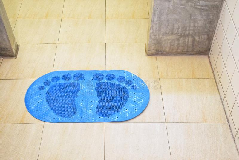Blue PVC Suction Anti Non Slip Bath Shower Mat Foot Massage Bathroom Accessories. In toilet stock image
