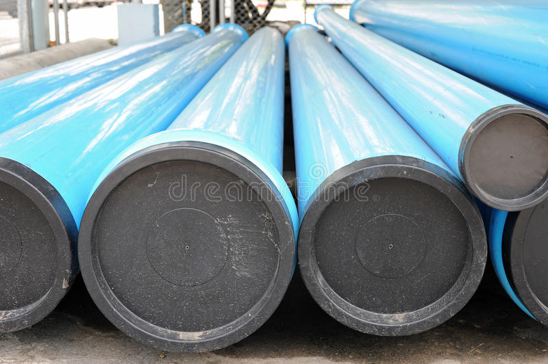 Blue PVC water pipes with covers