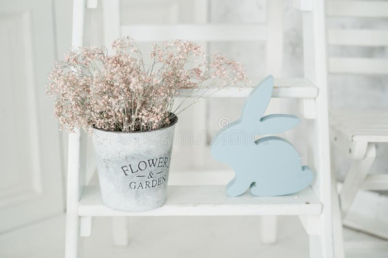 Blue Rabbit Easter Holiday Flower Pot Decor. Concept Background. Happy Celebration in Elegant Pastel Room Decoration. Diy Wooden Spring Things for Dinning Room stock images