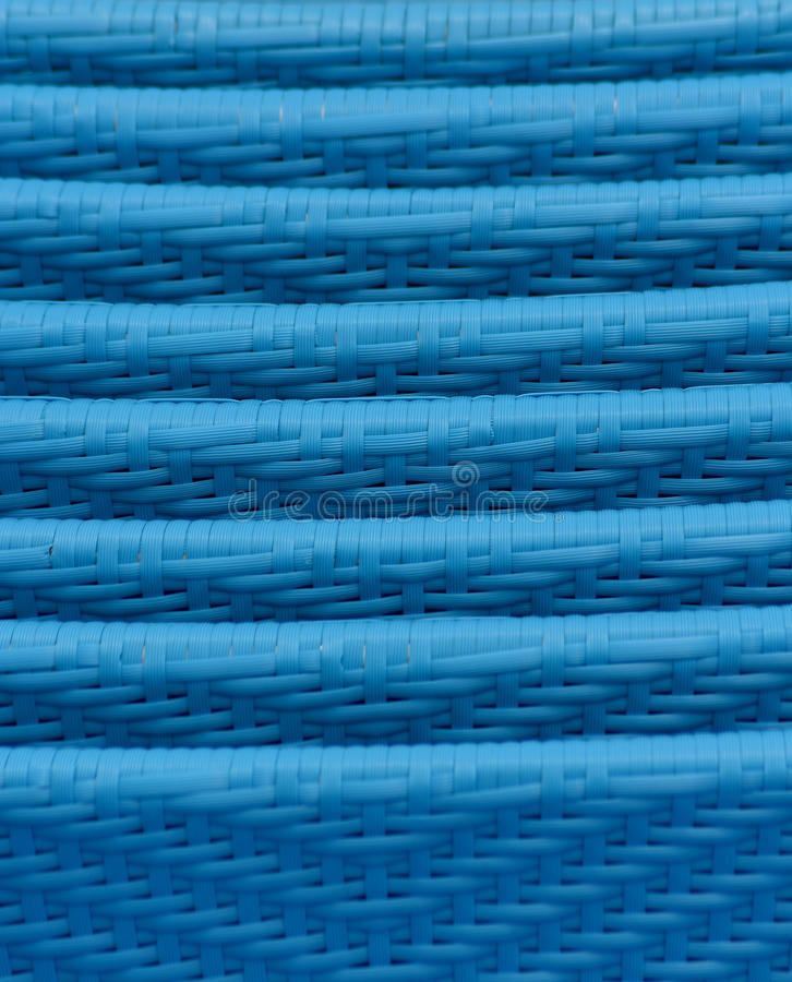 Blue rattan wicker chairs stacked closeup royalty free stock images