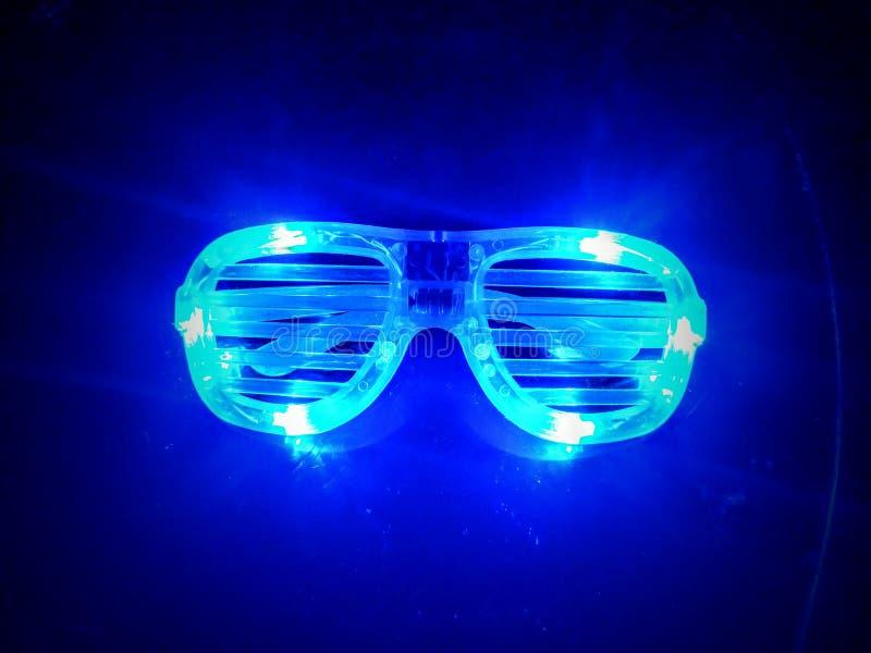 Blue Rave Glasses. Blue neon light Rave Glasses royalty free stock images