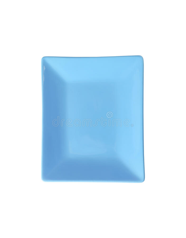 Blue rectangular plate. Cut out of blue rectangular plate on white background stock image