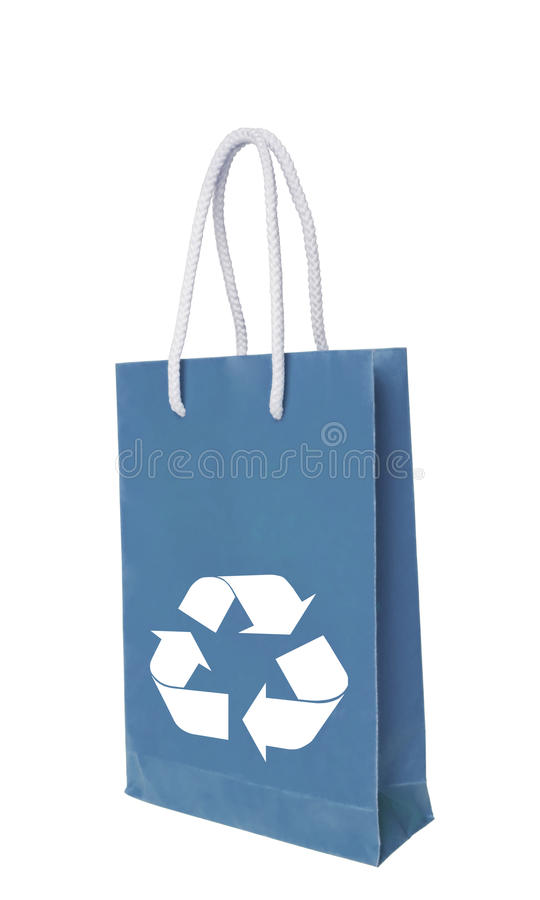 Blue recycle paper shopping bag. Over white floor stock photos