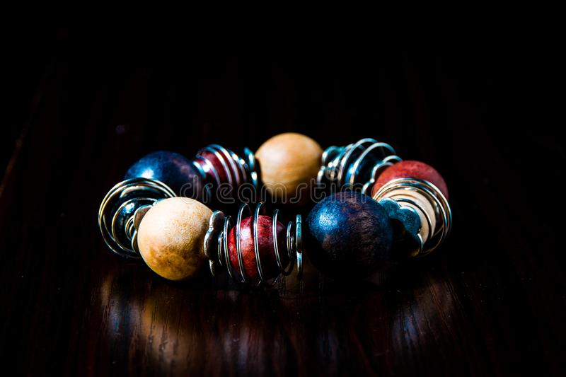 Blue, Red, Beige, and Silver Beaded Bracelet stock images