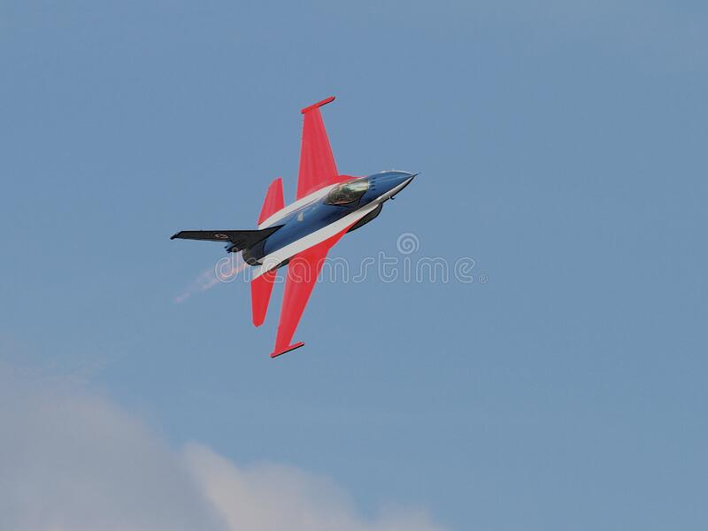 Blue Red Black and White Jet Plane on Air royalty free stock photo