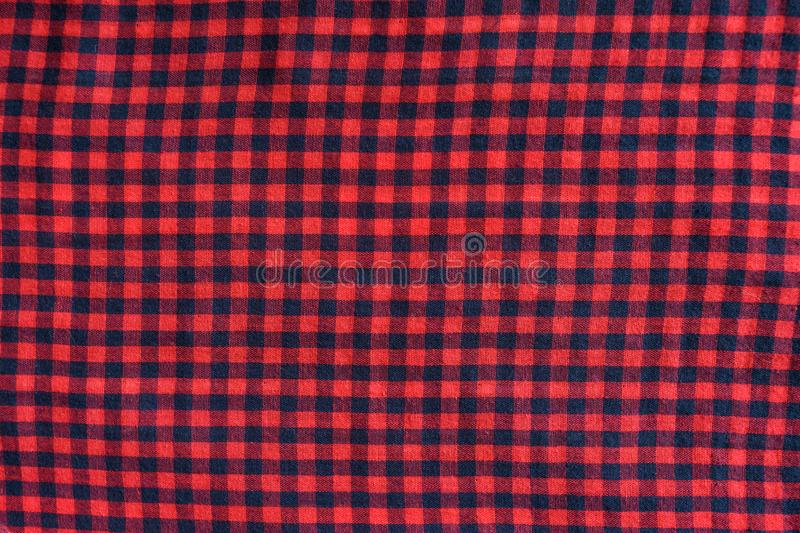 Blue with red checkered seamless fabric. Textural background.  royalty free stock photos