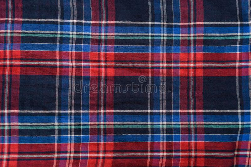Blue with red checkered seamless fabric. Textural background.  royalty free stock images