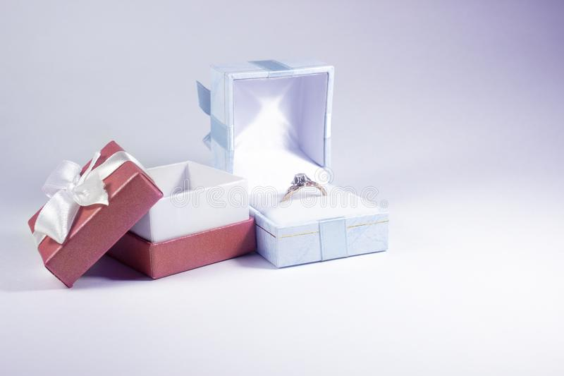 Blue and red gift boxes with jewelry royalty free stock image